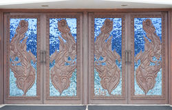 Chapel wooden door decorated. Stock Image
