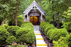 Chapel in woods. A view of a small Catholic (Christian) prayer chapel in the woods at the The National Shrine Grotto of Lourdes, Emmitsburg, Maryland Stock Photo