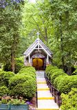 Chapel in woods. A view of a small Catholic (Christian) prayer chapel in the woods at the The National Shrine Grotto of Lourdes, Emmitsburg, Maryland. Vertical Royalty Free Stock Photos