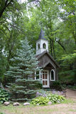 Chapel in the Woods. A historical chapel tucked away in the woods Stock Photos