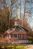 Chapel in the woods. Wooden chapel with a weather vane in the form of a golden angel in the woods on the holy spring Royalty Free Stock Photos