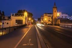 Chapelle de Carmen et de pont Isabel II en Séville Photos stock