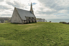 Chapelle Notre dame de la Garde. At the famous French Etretat coastline with a steep hills at sunny day Stock Photo