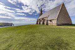 Chapelle Notre dame de la Garde. At the famous French Etretat coastline with a steep hills at sunny day Royalty Free Stock Photography