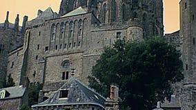 Chapelle Notre-Dame-sous-Terre Abbey. Archangel Michael statue atop the tower of Chapelle Notre-Dame-sous-Terre of abbey monastery. Historic Saint Michael`s stock video footage