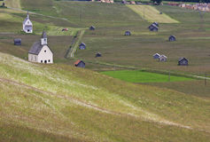 Chapels and hay-huts in Obertilliach, Austria. Obertilliach in Austrian Eastern Tyrol is nestled between the Lienzer Dolomites and the Carnic Alps. The little Stock Photography