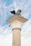 Chapiter of Saint Mark. Ancient column with the winged lion by the symbol of city Venice royalty free stock image