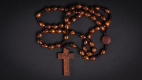 Chaplet - Faith. Handmade wooden chaplet - rosary in front of black background Stock Photography