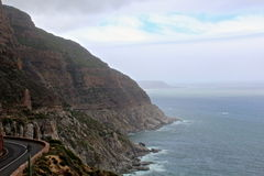 Chapman's Peak. View of the winding Chapman's Peak road in the South African mountains along the ocean coast stock images