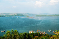 Chapora River, coastline view with boats, Goa, India Stock Photos