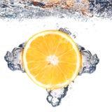 Chapoteo anaranjado Imagenes de archivo