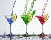 Chapoteo coloreado del agua en vidrio Foto de archivo libre de regalías