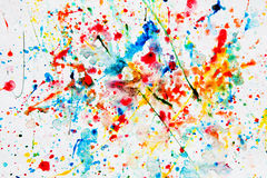Chapoteo colorido de la acuarela en el Libro Blanco Fotografía de archivo