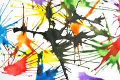 Chapoteo colorido de la pintura fotos de archivo
