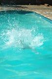 Chapoteo de la piscina Fotos de archivo libres de regalías