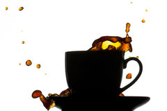 Chapoteo de la taza de café Fotos de archivo