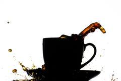 Chapoteo de la taza de café Imagenes de archivo