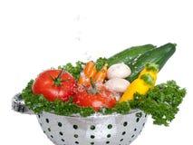 Chapoteo de las verduras frescas Fotografía de archivo
