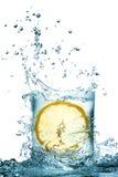 Chapoteo del agua en vidrio Imagen de archivo