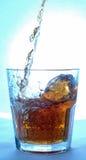 Chapoteo del alcohol Fotografía de archivo libre de regalías