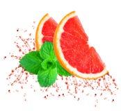 Chapoteo del jugo de pomelo foto de archivo libre de regalías