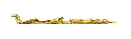 Chapoteo del oro de Liguid Fotos de archivo libres de regalías