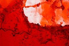Chapoteo del vino rojo - fondo abstracto ascendente cercano fotografía de archivo