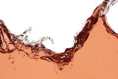 Chapoteo del vino rosado - fondo abstracto ascendente cercano fotografía de archivo libre de regalías
