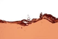 Chapoteo del vino rosado - fondo abstracto ascendente cercano foto de archivo libre de regalías