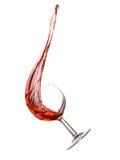 Chapoteo del vino rosado sobre blanco Fotografía de archivo libre de regalías