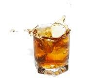 Chapoteo del whisky foto de archivo libre de regalías