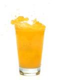 Chapoteo del zumo de naranja Imágenes de archivo libres de regalías