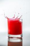 Chapoteo líquido rojo Imagen de archivo libre de regalías
