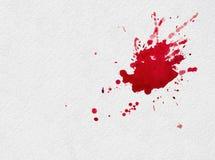 Chapoteo rojo de la acuarela Fotografía de archivo