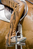 Chaps with fringe. Close up of custom horse back riding chaps with fringe stock photo