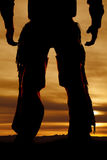 Chaps hands ready silhouette. A cowboys legs silhouetted in the sunset Stock Photo