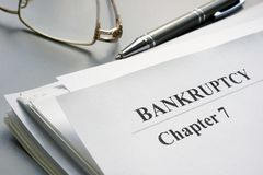 Chapter 7 Bankruptcy petition and glasses. Chapter seven Bankruptcy petition and glasses royalty free stock images