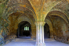 Chapter House of a Medieval Abbey. Remains of an historic Cistercian monastery - Kirkstall Abbey HDR image Stock Images