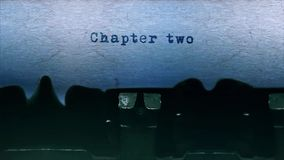 Chapter two Word  Typing  Centered on a Sheet of paper on old Typewriter audio. Word closeup Being Typing With Sound and Centered on a Sheet of paper on old stock video footage