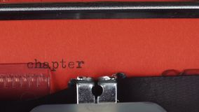 Chapter 3 - Typed on a old vintage typewriter. Printed on red paper. The red paper is inserted into the typewriter stock video
