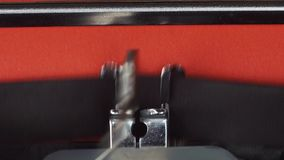 Chapter 2 - Typed on a old vintage typewriter. Printed on red paper. The red paper is inserted into the typewriter.  stock footage