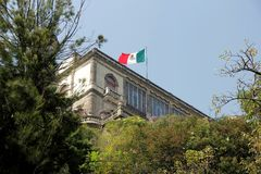 Chapultepec Castle and Mexican Flag over. Symbol of Mexican glory and patriotism in CDMX in Chapultepec Park Stock Photos
