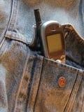 Chaqueta de Jean con el teléfono celular Foto de archivo