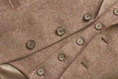 Chaqueta de tweed con sus detalles de botones imagen de archivo
