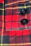 chaqueta negra del detalle de la manga de los botones Imagen de archivo libre de regalías