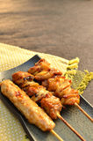 Char-broiled chicken called yakitori. Royalty Free Stock Images