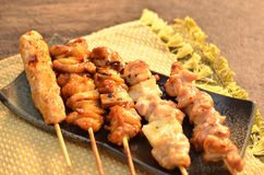 Char-broiled chicken called yakitori. Royalty Free Stock Photos