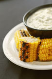 Char grilled corn on the cob Stock Photo