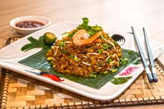 CHAR KWAY TEOW. Literally `stir-fried ricecake strips`, is a popular noodle dish in Malaysia, Singapore, Brunei and Indonesia. The dish is considered a royalty free stock image
