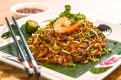 CHAR KWAY TEOW. Literally `stir-fried ricecake strips`, is a popular noodle dish in Malaysia, Singapore, Brunei and Indonesia. The dish is considered a stock image